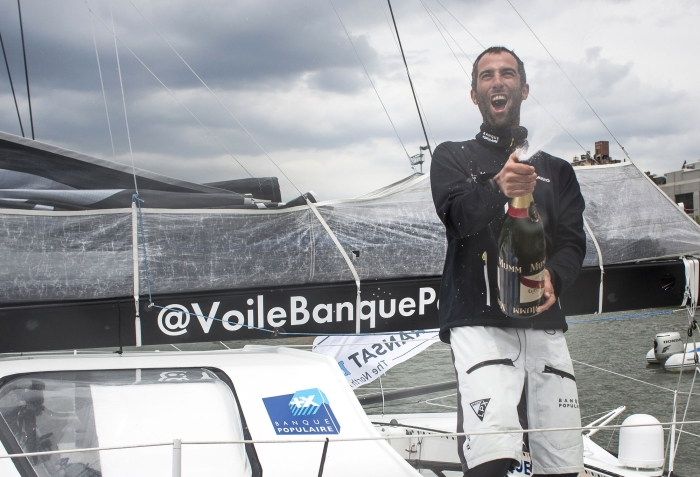 NEW YORK, NY - MAY 14: Armel Le Cleac'h onboard his Banque Populaire foiling IMOCA Open60 yacht, shown here celebrating after winning the 'Transat Bakerley' solo transatlantic yacht race. The yachtsman finished in 1st place, crossing the finish line in 12 days, 2 hours , 28 minutes and 39 seconds. May 14, 2016 on the Hudson River in New York City. (Photo by Lloyd Images)