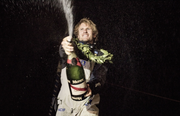 NEW YORK, NY - MAY 10: Francois Gabart on board his MACIF 'Ultim' 105ft trimaran, shown here celebrating after winning the 'Transat Bakerley' solo transatlantic yacht race. The yachtsman set a new world record for the solo transatlantic crossing in 8 days, 8 hours 54 minutes and 39 seconds. The race started in Plymouth, UK on Monday May 3rd.  May 10, 2016 on the Hudson River in New York City.  (Photo by Lloyd Images)